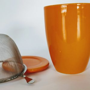 Camellia te Te Krus med te si og låg Orange